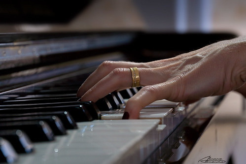 My wife playing piano ... | by Alvaro Almeida (read my profile)