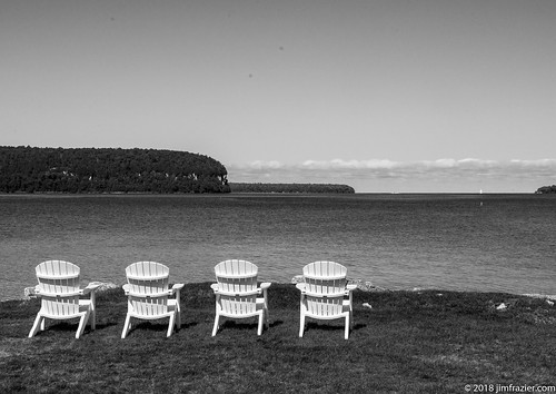 The quintessential Door County image - empty Adirondak chairs looking out over water | by Jim Frazier