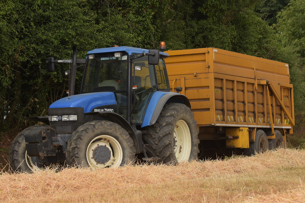 New Holland TM150 Tractor with a Dooley Grain Trailer | Flickr