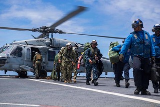 Sailors conduct a personnel transfer during Typhoon Mangkhut recovery efforts | by #PACOM