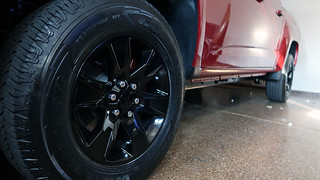 Close-up of painted black wheels and red quartz tintcoat brake calipers | by Parkzer