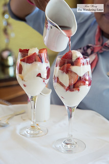Strawberries and fresh whipped cream topped with Chambord (the other coupe was topped with Grand Marnier) | by thewanderingeater