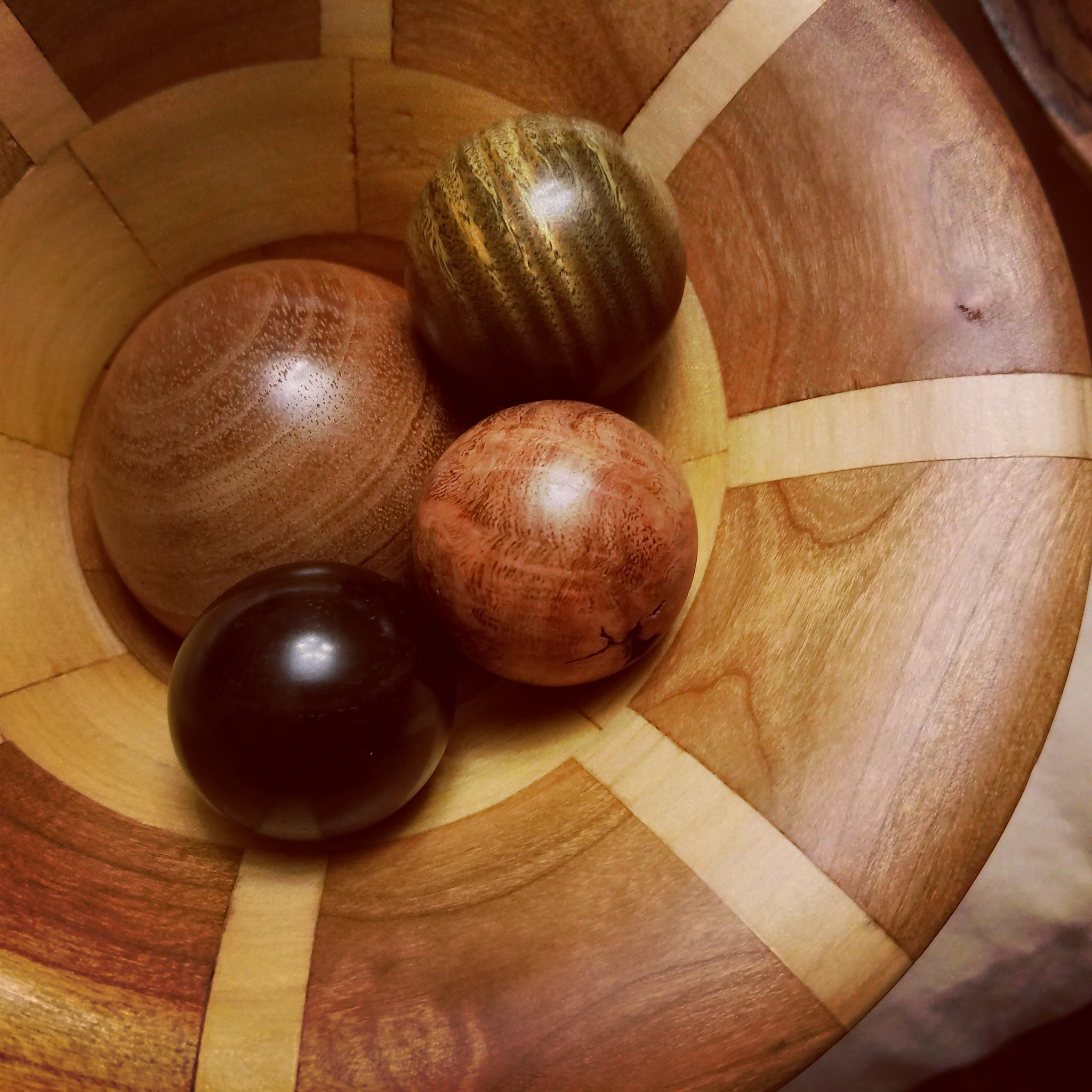 Some wooden spheres I made, finished with some pen wax