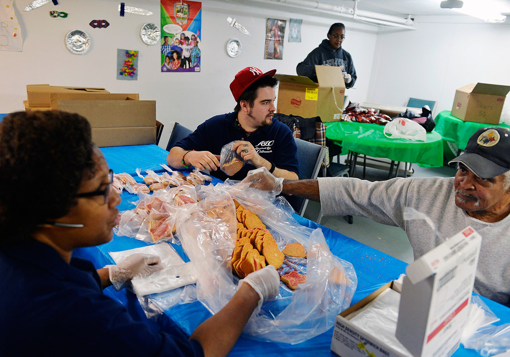 © 2016 by The York Daily Record/Sunday News. Tanner Doyle, 24, center, bags up shortbread cookies for York City schoolchildren at his job with Abundant Life Outreach in the basement of New Covenant Community Church, which operates the neighboring West King Street recovery house where Doyle has lived since June 2015, on Friday, Jan. 15, 2016. Doyle is now a member of the church.