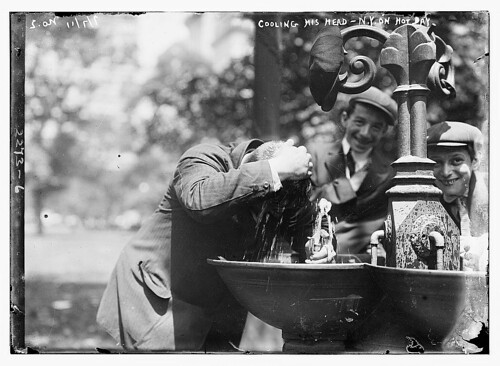 Cooling his head - N.Y. on hot day  (LOC) | by The Library of Congress