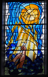 Stained Glass Window of arms ringing bell rope and bell - St James, Whitehaven