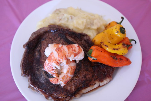 Pan Seared Ribeye with Lobster Tail, Blistered Sweet Peppers, and Truffle Gouda Mashed Potatoes