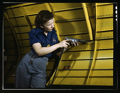 "Operating a hand drill at Vultee-Nashville, woman is working on a ""Vengeance"" dive bomber, Tennessee  (LOC) 