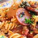fusilli puttnesca with spicy pinto sausages