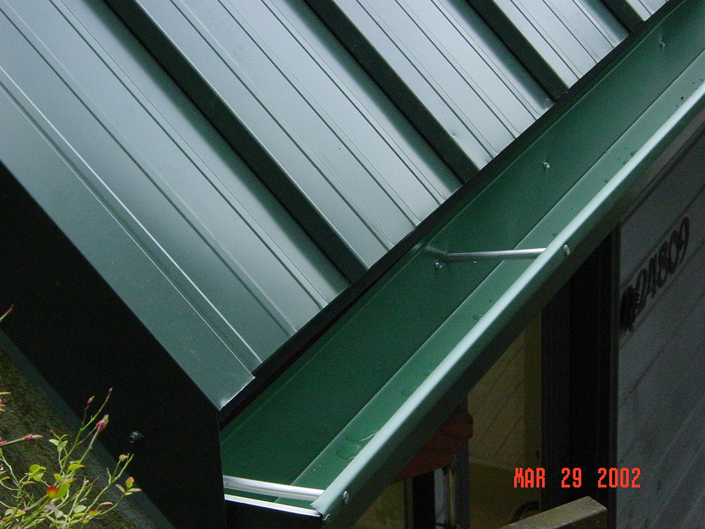 Edge Detail On Metal Roofing System In Gutter This Job