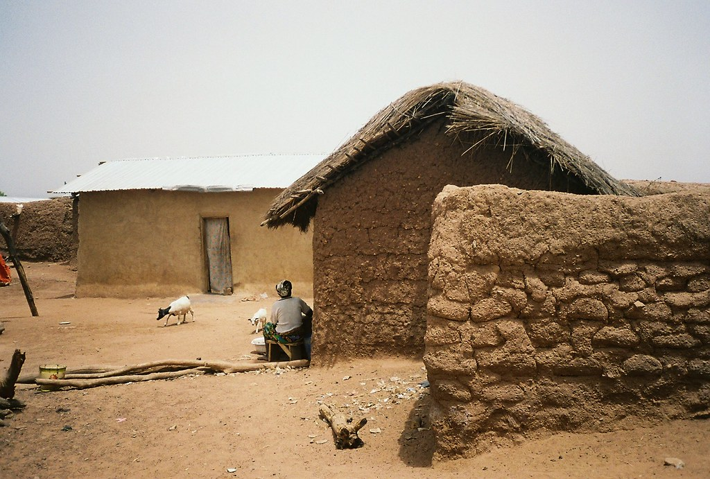Ghana Fufulsu Village Scene With Traditional Mud Houses