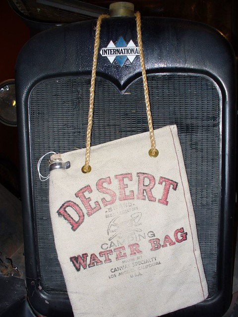 Desert Water Bag A Water Bag Hanging In Front Of A Car