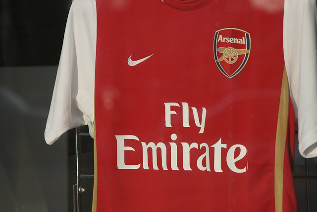 fly emirates in the window of a soccer store by