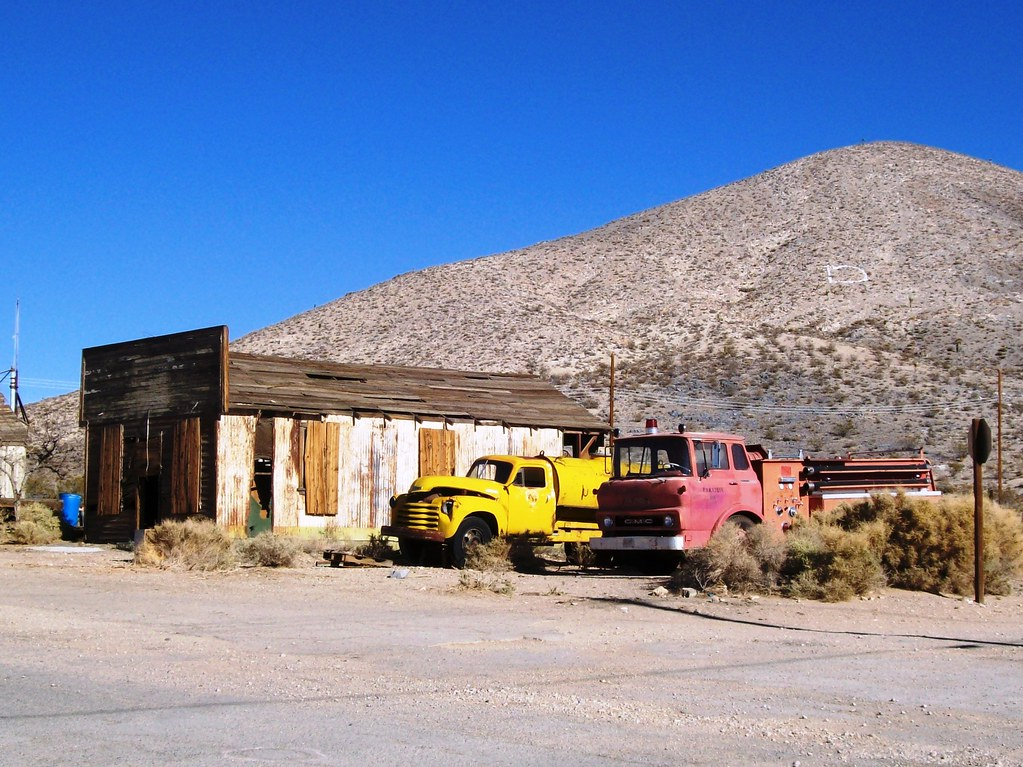 Abandoned building and junked trucks across from the Darwi… | Flickr