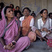 Women attend a community meeting
