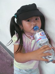 gwenny with daddy's hat and mommy's water