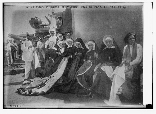 "Nuns from Bengasi repairing Italian flag on the ""PISA""  (LOC) 