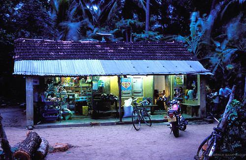 Village shop at dusk lit by solar panels | by World Bank Photo Collection