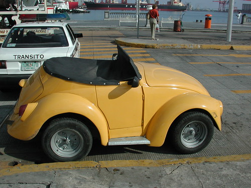 A Very Short Vw Beetle Parked In San Miguel Cozumel