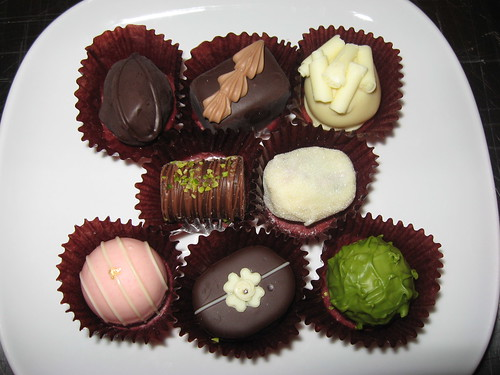 Mary's Chocolate: Handmade chocolates - prune, gianduja fruit, cointreau, gianduja nut, champagne, fraise, raisin, the vert (close up) | by yummyinthetummyblog