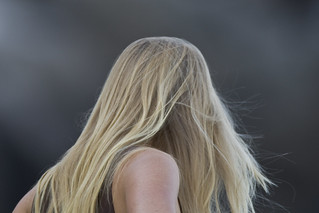 Blond long-haired young lady woman girl watching the surfers at Morro Bay, CA | by mikebaird