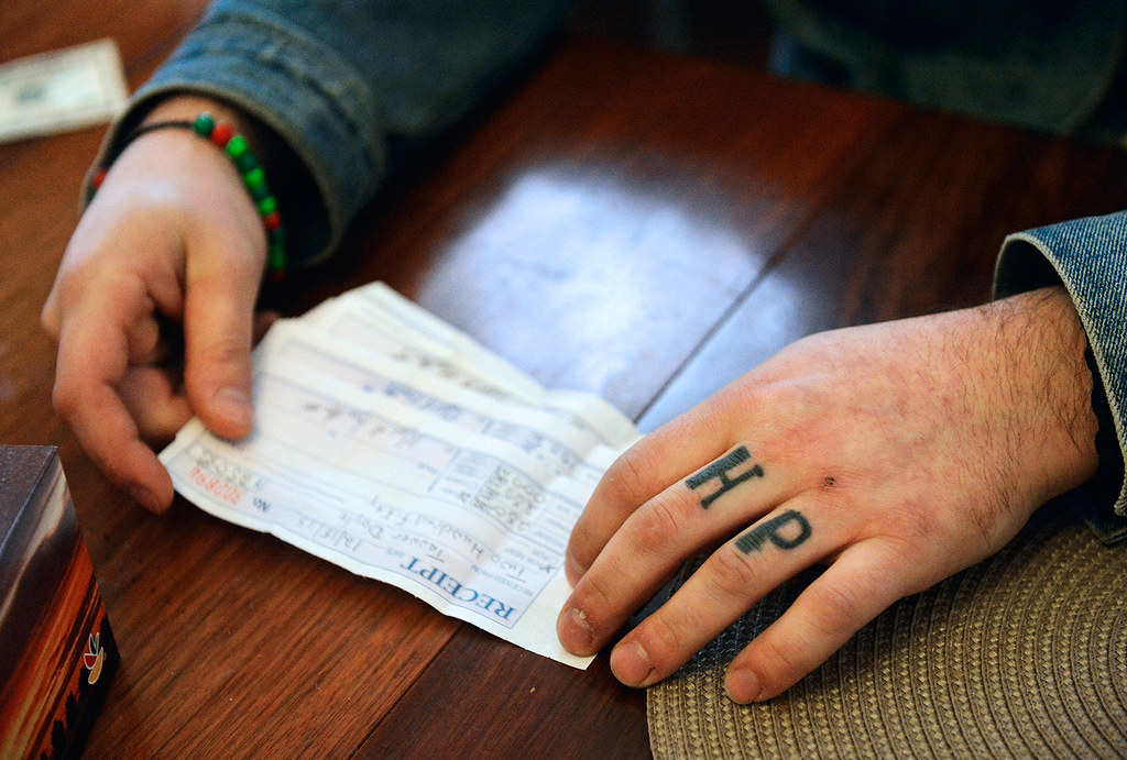 © 2016 by The York Daily Record/Sunday News. Tanner Doyle, 24, pages through his rent receipts after catching up on his payments at True North, a West King Street recovery house where he has lived since June 2015, on Friday, Jan. 15, 2016. Doyle said he received the