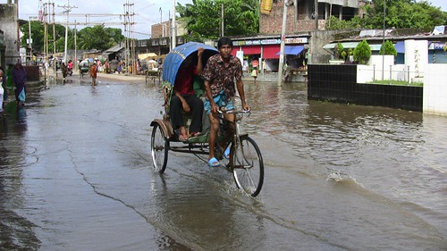 Rickshaw Riding in Flood | by uncultured