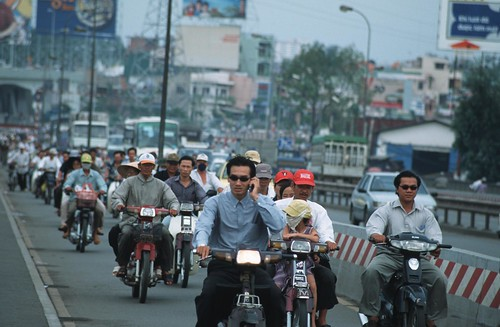 In Vietnam, motorcycles are one of the main forms of transportation | by World Bank Photo Collection