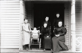 Small group with baby | by Special Collections & University Archives (ISU)