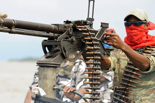 "Nigerian rebels have threatened an ""all out war"" in the oil-producing regions of the country. The rebels point to the environmental degradation and exploitation of petroleum resources as the basis of their struggle. 