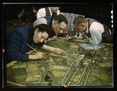 Camouflage class in New York University, where men and women are preparing for jobs in the Army or in industry, New York, N.Y. They make models from aerial photographs, re-photograph them, then work out a camouflage scheme and make a final photograph  (LO | by The Library of Congress