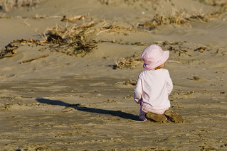 Young toddler female girl playing in the sand in late evening light | by mikebaird