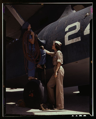 Women are contributing their skills to the nation's needs by keeping our country's planes in top-notch fighting condition, Corpus Christi, Texas. Wife of a disabled World War I veteran, Mrs. Cora Ann Bowen (left) works as a cowler at the Naval Air Base. M | by The Library of Congress