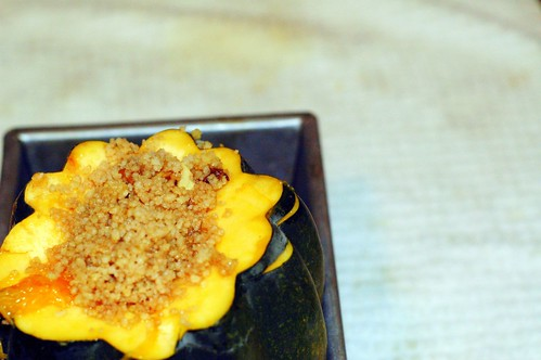 roasted acorn squash stuffed with spiced couscous in a wine reduction sauce | by sassyradish