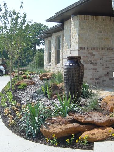 Custom Landscape Design and Cobblestone Drainage Dry Creek