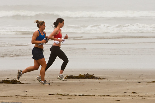 Two female joggers on foggy Morro Strand State Beach | by mikebaird