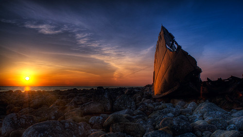 Sunset on an old wreck | by Amundn