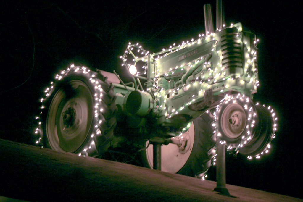 John Deere | Lighted John Deere Tractor on top of a building… | Flickr