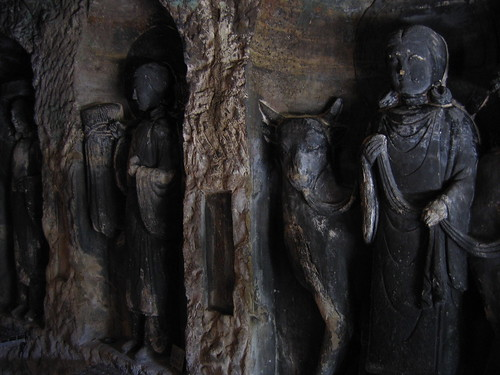 Benten kutsu wall carvings the is a cave
