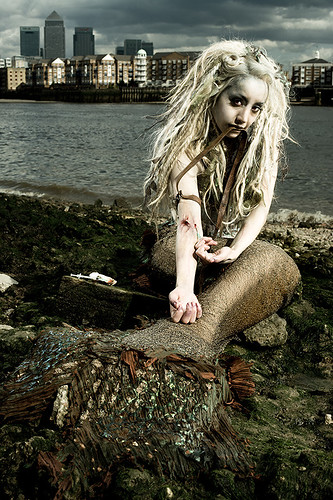 Mermaid shooting up heroin on the banks of the Thames in London | by Nathan Gallagher