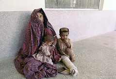 A women with children waits outside of a hospital | by World Bank Photo Collection