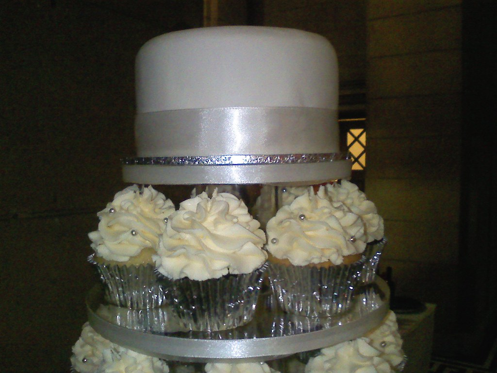 top cake of wedding cupcake stand top cake and ribbon on s