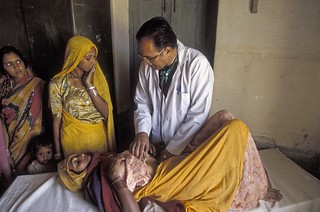 Female patient gets a check up | by World Bank Photo Collection
