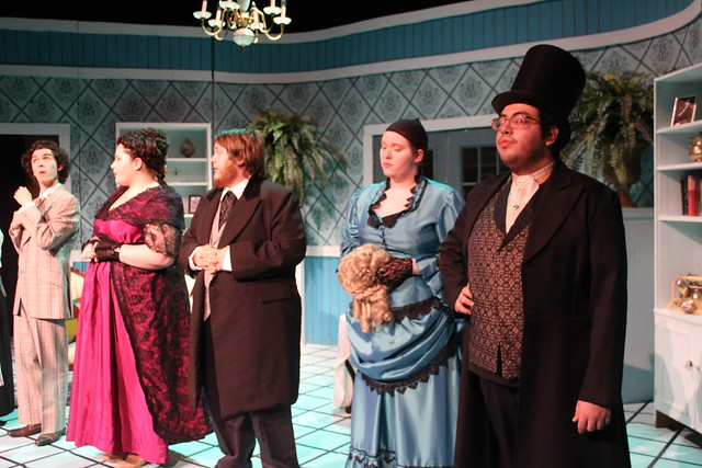Five characters are lined up across the stage for curtain call in Play On!