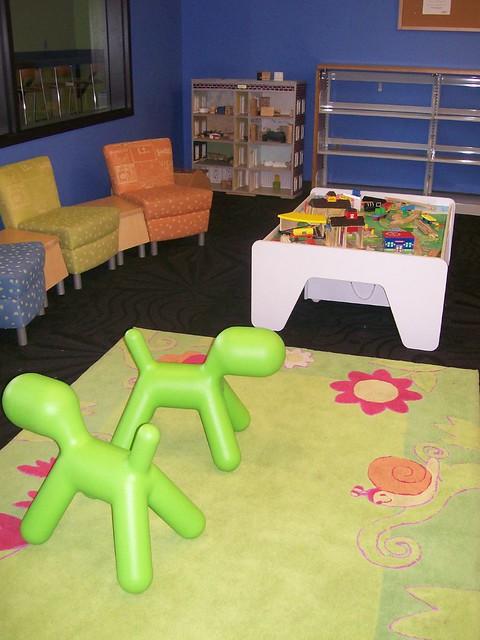 Preschool Table Toys : Preschool toy area with train table and dollhouse