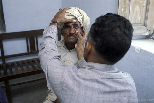 A man receives a medical checkup | by World Bank Photo Collection