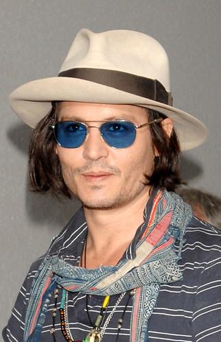 wearing cowboy hat back