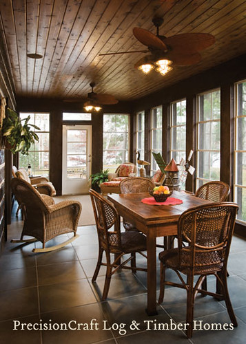 Sun room in a custom hybrid home located in wisconson for Log home sunrooms