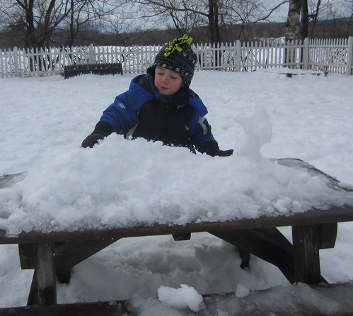 smashing his snow castles