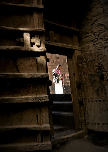 Man in the street seen from the inside through an old door - Sanaa - Yemen | by Eric Lafforgue